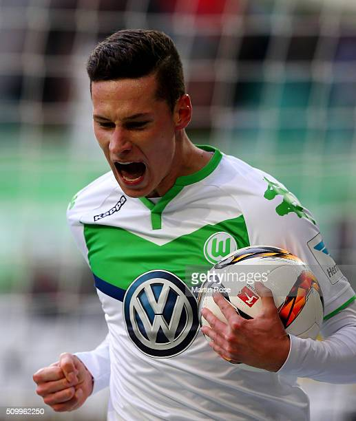 Julian Draxler of Wolfsburg celebrates after scoring the opening goal during the Bundesliga match between VfL Wolfsburg and FC Ingolstadt at...