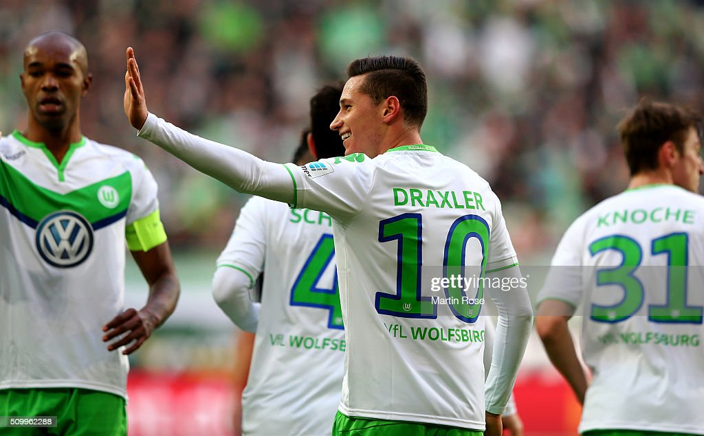 <a gi-track='captionPersonalityLinkClicked' href=/galleries/search?phrase=Julian+Draxler&family=editorial&specificpeople=7184479 ng-click='$event.stopPropagation()'>Julian Draxler</a> of Wolfsburg celebrates after scoring the opening goal during the Bundesliga match between VfL Wolfsburg and FC Ingolstadt at Volkswagen Arena on February 13, 2016 in Wolfsburg, Germany.
