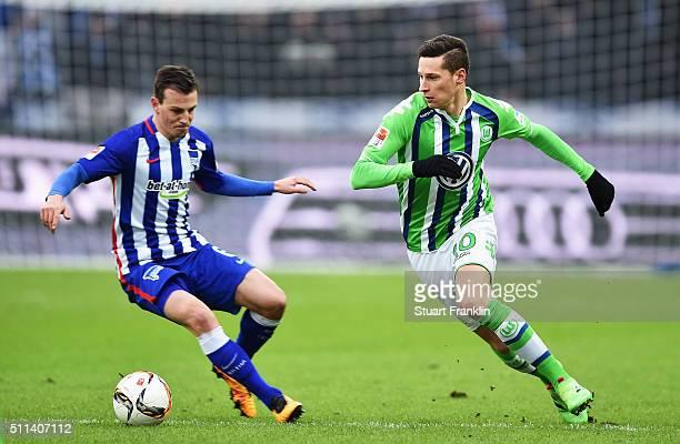 Julian Draxler of Wolfsburg is challenged by Marvin Plattenhardt of Berlin during the Bundesliga match between Hertha BSC and VfL Wolfsburg at...