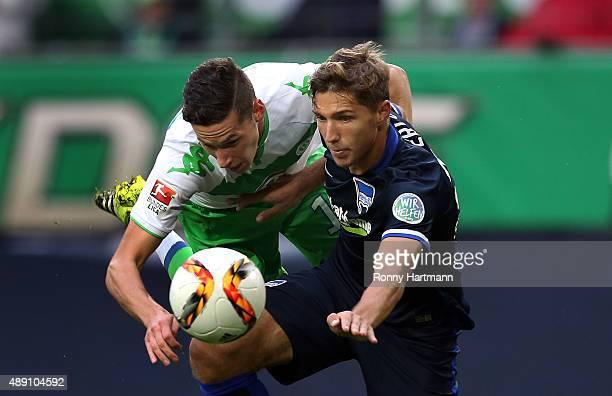 Julian Draxler of Wolfsburg vies with Niklas Stark of Berlin during the Bundesliga match between VfL Wolfsburg and Hertha BSC at Volkswagen Arena on...