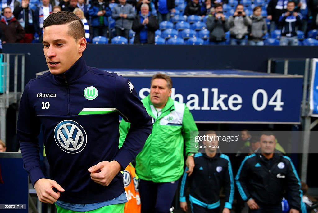 <a gi-track='captionPersonalityLinkClicked' href=/galleries/search?phrase=Julian+Draxler&family=editorial&specificpeople=7184479 ng-click='$event.stopPropagation()'>Julian Draxler</a> of Wolfsburg walks onto the pitch before the Bundesliga match between FC Schalke 04 and VfL Wolfsburg at Veltins-Arena on February 6, 2016 in Gelsenkirchen, Germany.