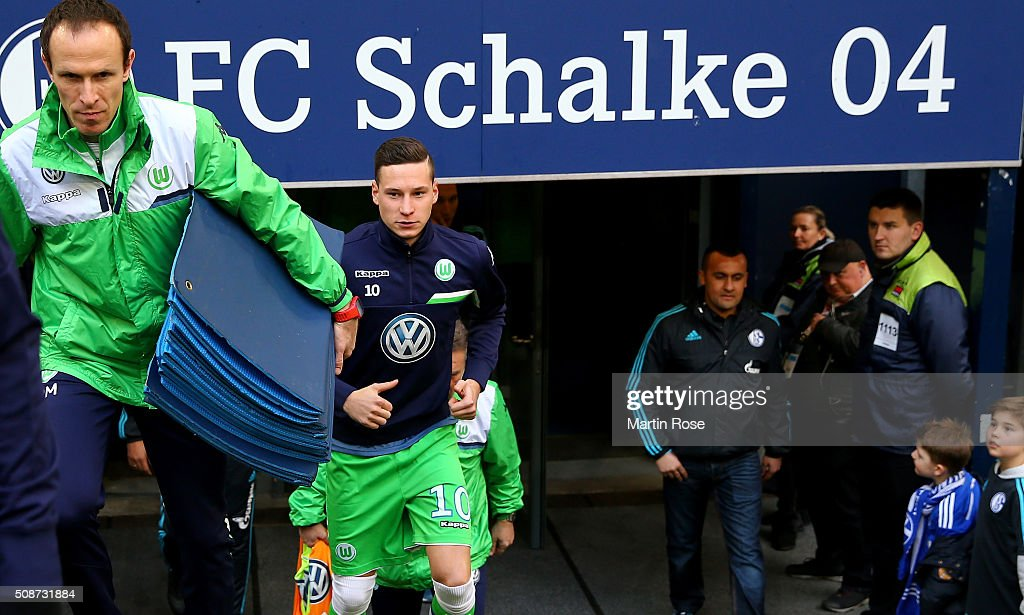 Julian Draxler of Wolfsburg walks onto the pitch before the Bundesliga match between FC Schalke 04 and VfL Wolfsburg at Veltins-Arena on February 6, 2016 in Gelsenkirchen, Germany.
