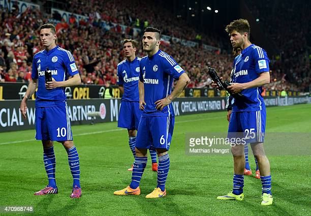Julian Draxler Sead Kolasinac and Klaas Jan Huntelaar of Schalke look dejected after losing the Bundesliga match between 1 FSV Mainz 05 and FC...