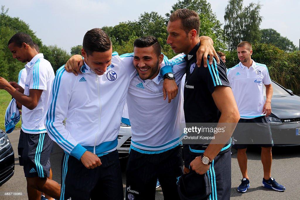 Julian Draxler, Sead Kolasinac and video analyst Tobias Hellwig smile during a test drive of Schalke at driving safety centre Rheinberg on August 12, 2015 in Rheinberg