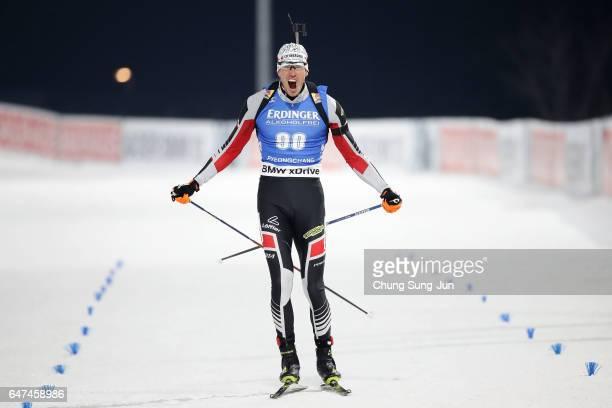 Julian Eberhard of Austria celebrates winning the Men 10km Sprint during the BMW IBU World Cup Biathlon 2017 test event for PyeongChang 2018 Winter...