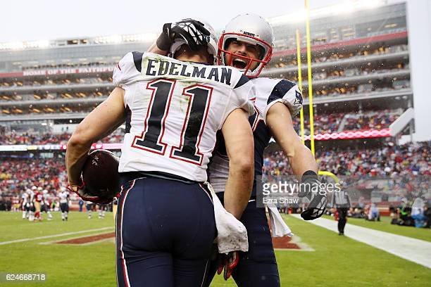 Julian Edelman celebrates with Danny Amendola of the New England Patriots after a fouryard touchdown reception against the San Francisco 49ers in the...
