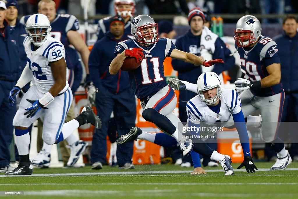 Julian Edelman #11 of the New England Patriots avoids a tackle by Pat McAfee #1 of the Indianapolis Colts before while returning a punt for a touchdown against in the first half during the game on November 18, 2012 at Gillette Stadium in Foxboro, Massachusetts.