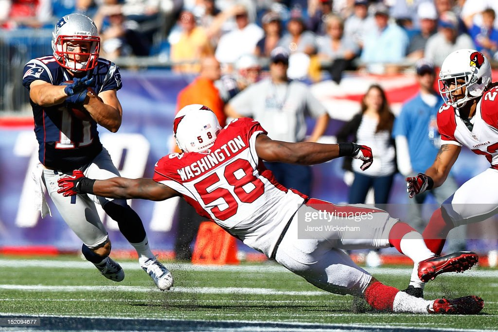 <a gi-track='captionPersonalityLinkClicked' href=/galleries/search?phrase=Julian+Edelman&family=editorial&specificpeople=4489543 ng-click='$event.stopPropagation()'>Julian Edelman</a> #11 of the New England Patriots avoids a tackle from Daryl Washington #58 of the Arizona Cardinals during the game on September 16, 2012 at Gillette Stadium in Foxboro, Massachusetts.