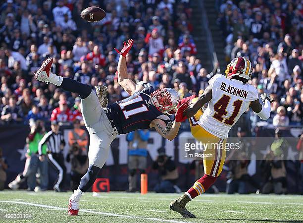Julian Edelman of the New England Patriots can't catch a pass as Will Blackmon of the Washington Redskins defends in the first quarter at Gillette...