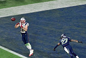 Julian Edelman of the New England Patriots catches a touchdown pass over Tharold Simon of the Seattle Seahawks in Super Bowl XLIX February 1 2015 at...