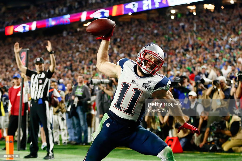 <a gi-track='captionPersonalityLinkClicked' href=/galleries/search?phrase=Julian+Edelman&family=editorial&specificpeople=4489543 ng-click='$event.stopPropagation()'>Julian Edelman</a> #11 of the New England Patriots celebrates as he scores a 3 yard touchdown in the fourth quarter against Seattle Seahawks during Super Bowl XLIX at University of Phoenix Stadium on February 1, 2015 in Glendale, Arizona.