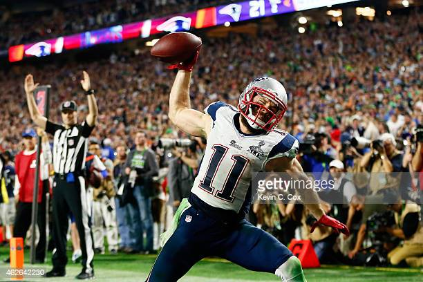 Julian Edelman of the New England Patriots celebrates as he scores a 3 yard touchdown in the fourth quarter against Seattle Seahawks during Super...