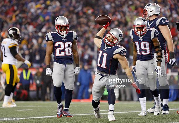 Julian Edelman of the New England Patriots celebrates scoring a touchdown during the third quarter against the Pittsburgh Steelers in the AFC...