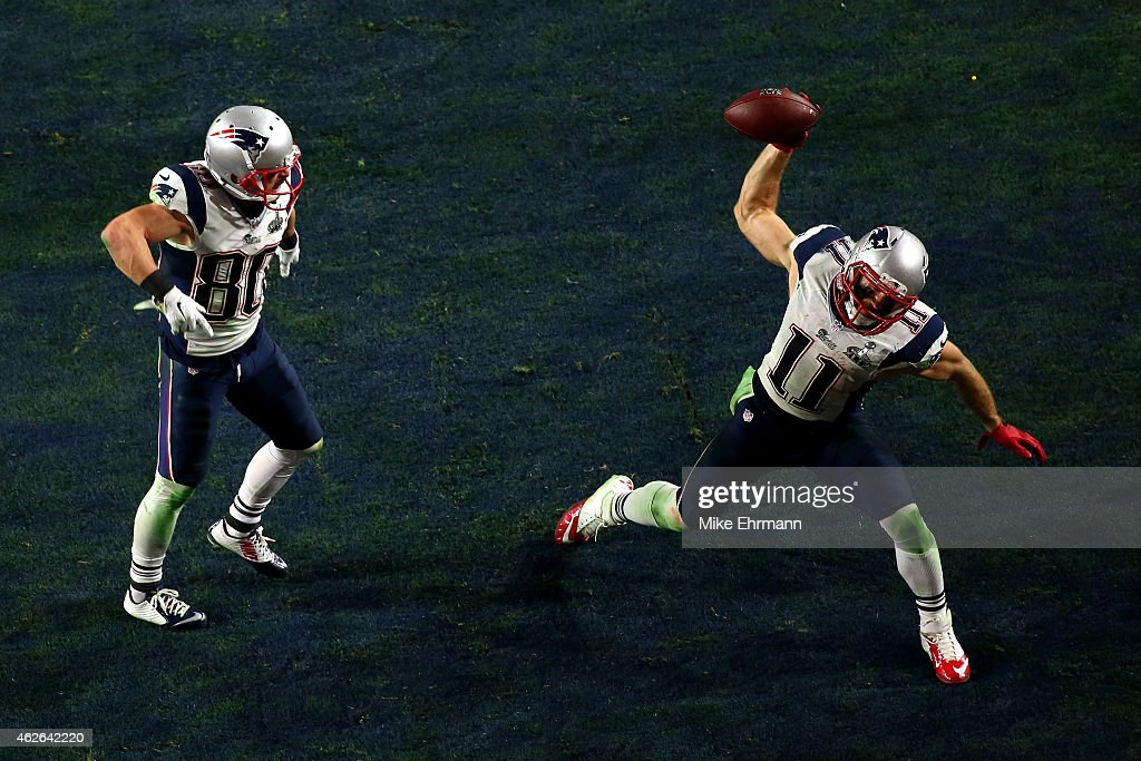 Julian Edelman #11 of the New England Patriots celebrates scoring on a three yard touchdown pass as Danny Amendola #80 looks on in the fourth quarter against the Seattle Seahawks during Super Bowl XLIX at University of Phoenix Stadium on February 1, 2015 in Glendale, Arizona.