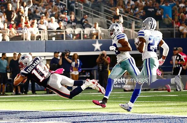 Julian Edelman of the New England Patriots dives across the goal line as Barry Church of the Dallas Cowboys and Corey White of the Dallas Cowboys are...