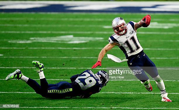 Julian Edelman of the New England Patriots eludes Earl Thomas of the Seattle Seahawks in the second quarter during Super Bowl XLIX at University of...