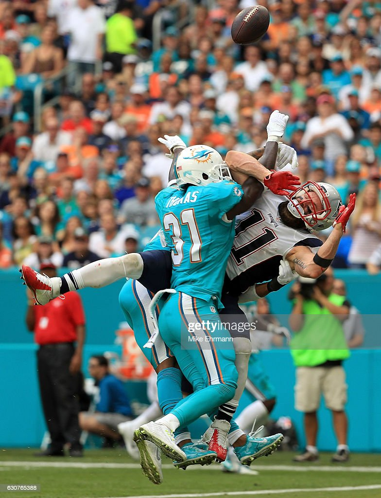Julian Edelman #11 of the New England Patriots has a pass blocked by Michael Thomas #31 of the Miami Dolphins during a game at Hard Rock Stadium on January 1, 2017 in Miami Gardens, Florida.