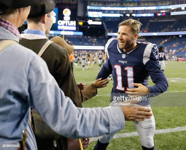 Julian Edelman of the New England Patriots interacts with the End zone Militia after a preseason game with the Jacksonville Jaguars at Gillette...