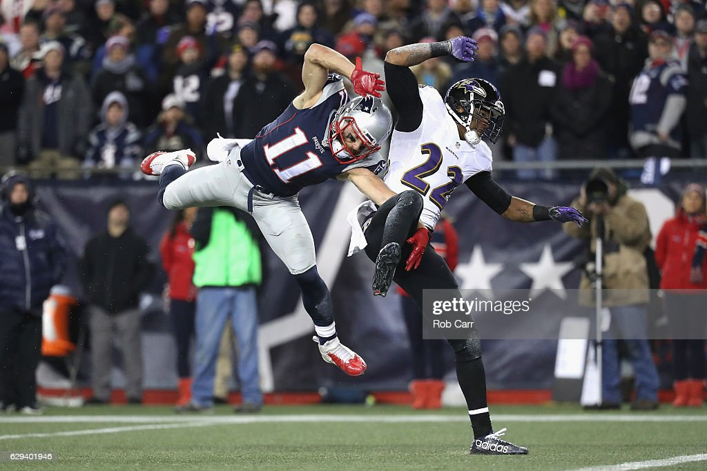 Julian Edelman #11 of the New England Patriots is unable to catch a pass during the first half as he is defended by Jimmy Smith #22 of the Baltimore Ravens at Gillette Stadium on December 12, 2016 in Foxboro, Massachusetts.