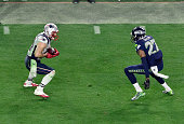 Julian Edelman of the New England Patriots looks to put a move on Tharold Simon of the Seattle Seahawks in Super Bowl XLIX February 1 2015 at the...