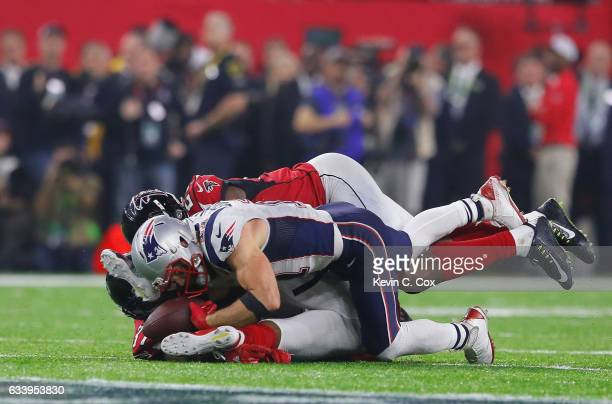 Julian Edelman of the New England Patriots makes a 23 yard catch in the fourth quarter against Ricardo Allen and Keanu Neal of the Atlanta Falcons...