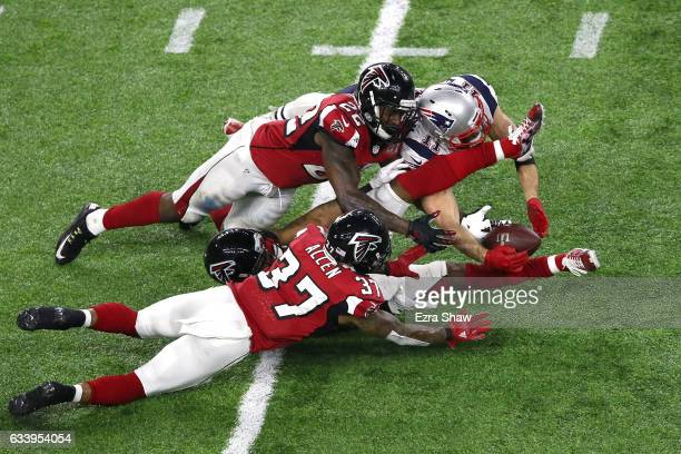 Julian Edelman of the New England Patriots makes a 23 yard catch in the fourth quarter against Ricardo Allen Robert Alford and Keanu Neal of the...