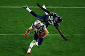 Julian Edelman of the New England Patriots makes a catch against Tharold Simon of the Seattle Seahawks in the second half during Super Bowl XLIX at...