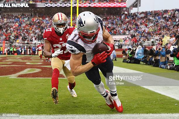 Julian Edelman of the New England Patriots makes a fouryard touchdown reception against the San Francisco 49ers in the first quarter of their NFL...