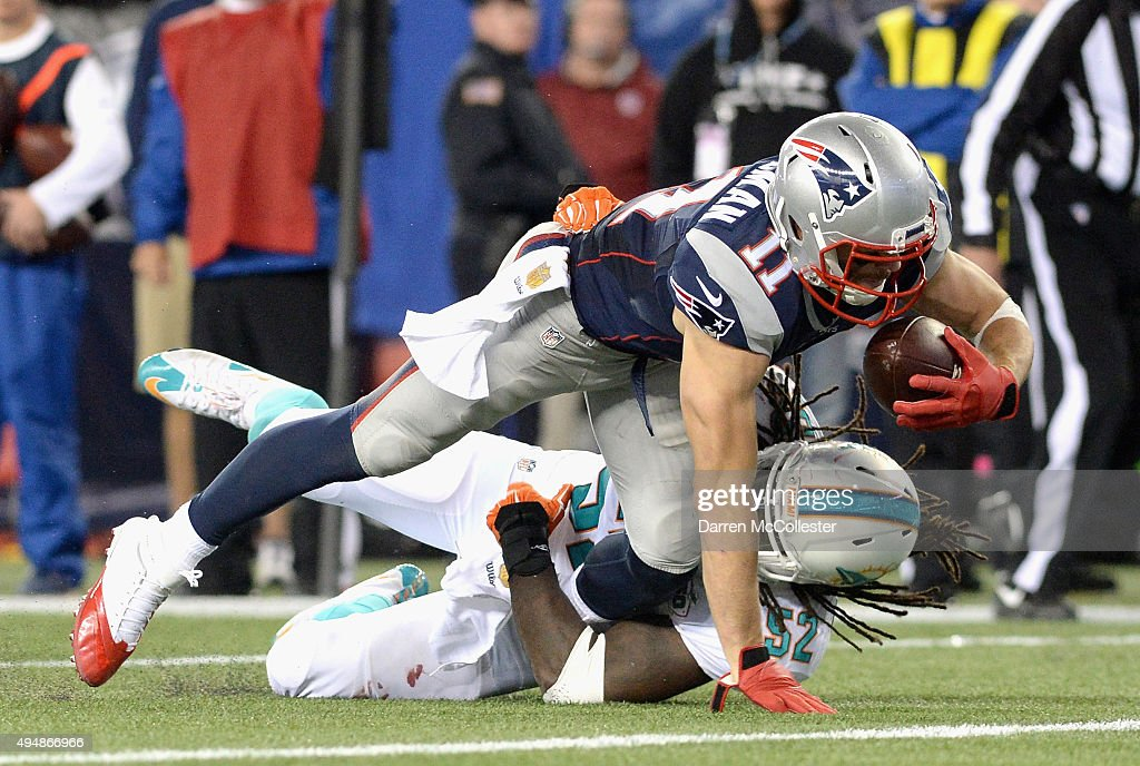 <a gi-track='captionPersonalityLinkClicked' href=/galleries/search?phrase=Julian+Edelman&family=editorial&specificpeople=4489543 ng-click='$event.stopPropagation()'>Julian Edelman</a> #11 of the New England Patriots reacts dives as he scores a touchdown during the fourth quarter against the Miami Dolphins at Gillette Stadium on October 29, 2015 in Foxboro, Massachusetts.