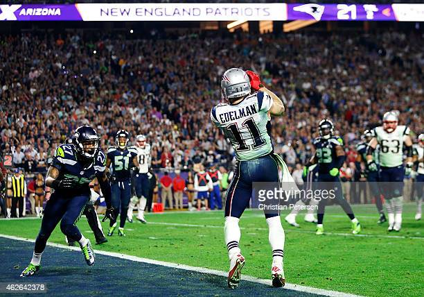 Julian Edelman of the New England Patriots scores a touchdown against the Seattle Seahawks in the fourth quarter during Super Bowl XLIX at University...