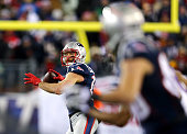 Julian Edelman of the New England Patriots throws a touchdown pass to Danny Amendola during the second half of the 2015 AFC Divisional Playoffs game...