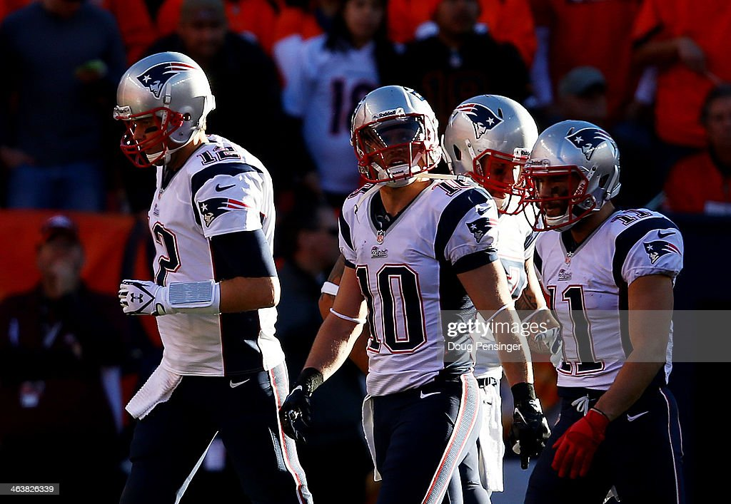 <a gi-track='captionPersonalityLinkClicked' href=/galleries/search?phrase=Julian+Edelman&family=editorial&specificpeople=4489543 ng-click='$event.stopPropagation()'>Julian Edelman</a> #11, <a gi-track='captionPersonalityLinkClicked' href=/galleries/search?phrase=Tom+Brady+-+American+Football+Quarterback&family=editorial&specificpeople=201737 ng-click='$event.stopPropagation()'>Tom Brady</a> #12 of the New England Patriots and teammates react after their fourth quarter touchdown against the Denver Broncos during the AFC Championship game at Sports Authority Field at Mile High on January 19, 2014 in Denver, Colorado.