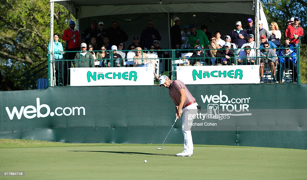 Julian Etulain of Argentina strokes a putt for birdie on the 18th green to tie for the lead during the final round of the Chitimacha Louisiana Open...