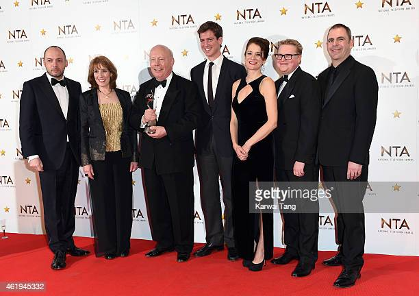 Julian Fellowes and crew pose in the winners room with the award for Best Drama for Downton Abbey at the National Television Awards at 02 Arena on...