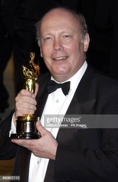 Julian Fellowes with his Best Screenplay Oscar arriving the Vanity Fair post Oscars party held at the Morton's restaurant in Los Angeles