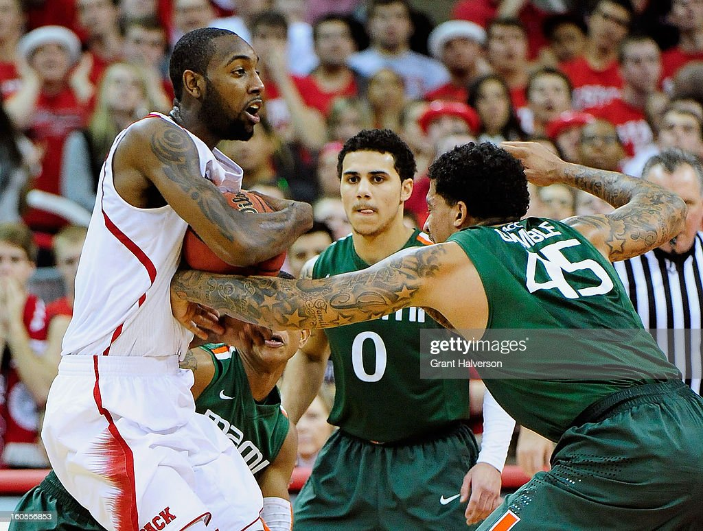 Julian Gamble #45 and Shane Larkin #0 of the Miami Hurricanes pressure <a gi-track='captionPersonalityLinkClicked' href=/galleries/search?phrase=C.J.+Leslie&family=editorial&specificpeople=6902920 ng-click='$event.stopPropagation()'>C.J. Leslie</a> #5 of the North Carolina State Wolfpack during play at PNC Arena on February 2, 2013 in Raleigh, North Carolina. Miami won 79-78.