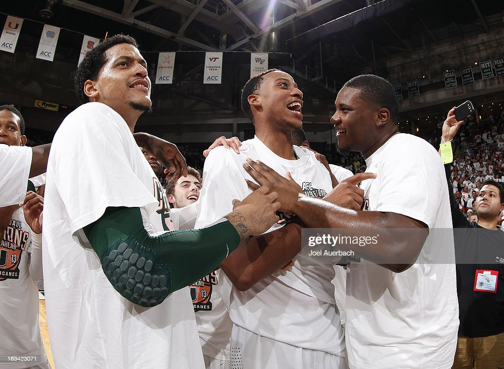 Julian Gamble #45, Kenny Kadji #35, and Reggie Johnson #42 of the Miami Hurricanes celebrate after the game against the Clemson Tigers on March 9, 2013 at the BankUnited Center in Coral Gables, Florida. The Hurricanes defeated the Tigers 62-49 and won the Atlantic Coast Conference Championship.