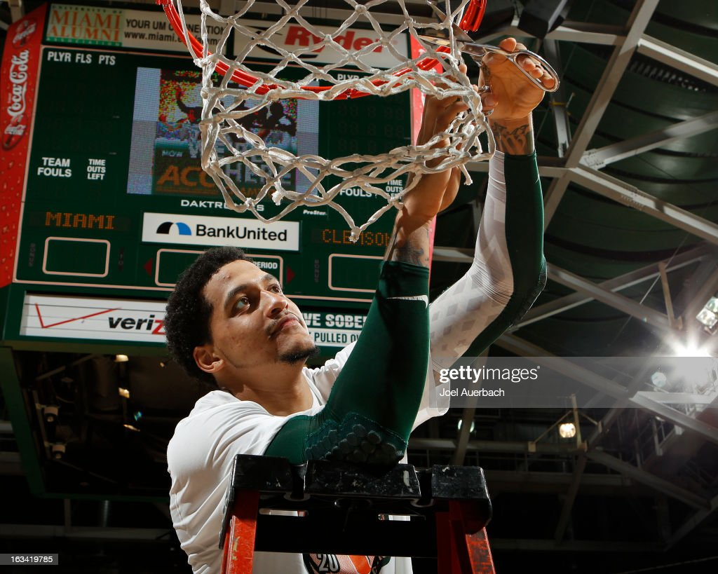 Julian Gamble #45 of the Miami Hurricanes cuts the net down after the game against the Clemson Tigers on March 9, 2013 at the BankUnited Center in Coral Gables, Florida. The Hurricanes defeated the Tigers 62-49 and won the Atlantic Coast Conference Championship.