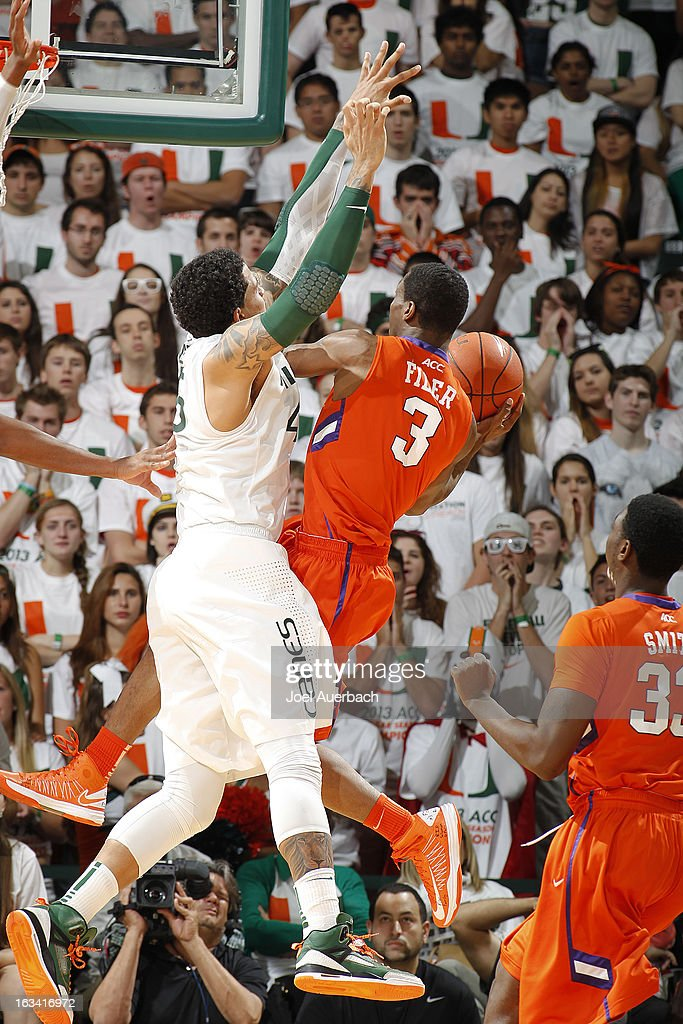 Julian Gamble #45 of the Miami Hurricanes defends against Adonis Filer #3 of the Clemson Tigers on March 9, 2013 at the BankUnited Center in Coral Gables, Florida.