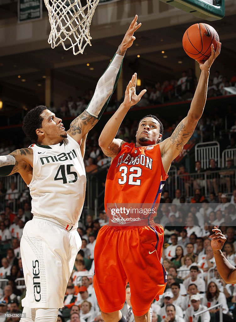Julian Gamble #45 of the Miami Hurricanes defends the shot by K.J. McDaniels #32 of the Clemson Tigers on March 9, 2013 at the BankUnited Center in Coral Gables, Florida. The Hurricanes defeated the Tigers 62-49 and won the Atlantic Coast Conference Championship.