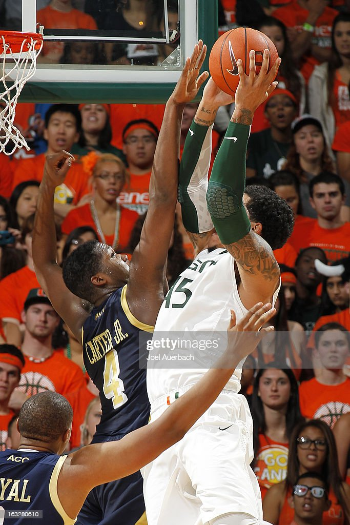 Julian Gamble #45 of the Miami Hurricanes has his shot defended by Robert Carter, Jr. #4 of the Georgia Tech Yellow Jackets on March 6, 2013 at the BankUnited Center in Coral Gables, Florida. Georgia Tech defeated Miami 71-69.