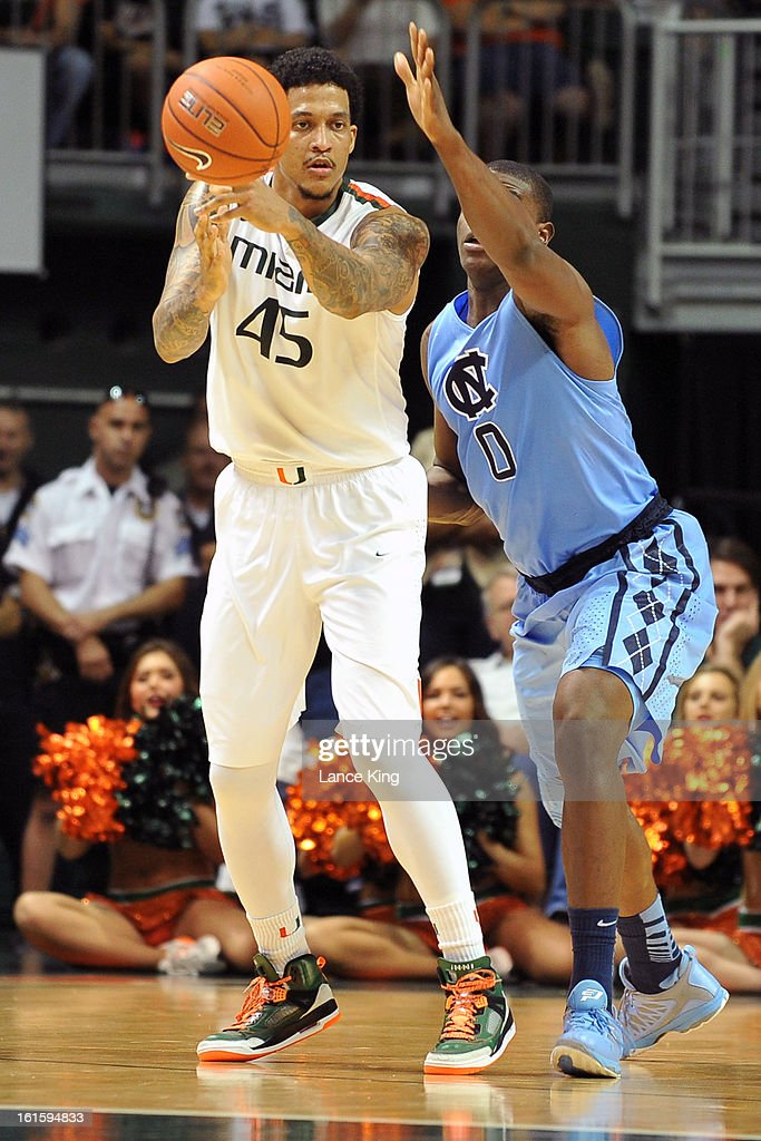 Julian Gamble #45 of the Miami Hurricanes passes the ball against Joel James #0 of the North Carolina Tar Heels at the BankUnited Center on February 9, 2013 in Coral Gables, Florida. Miami defeated North Carolina 87-61.