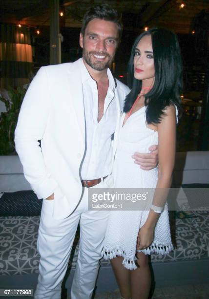 Julian Gil and actress Scarlet Gruber pose at River Yatch Club during the US launch of Carson Life on April 20 2017 in Miami Us