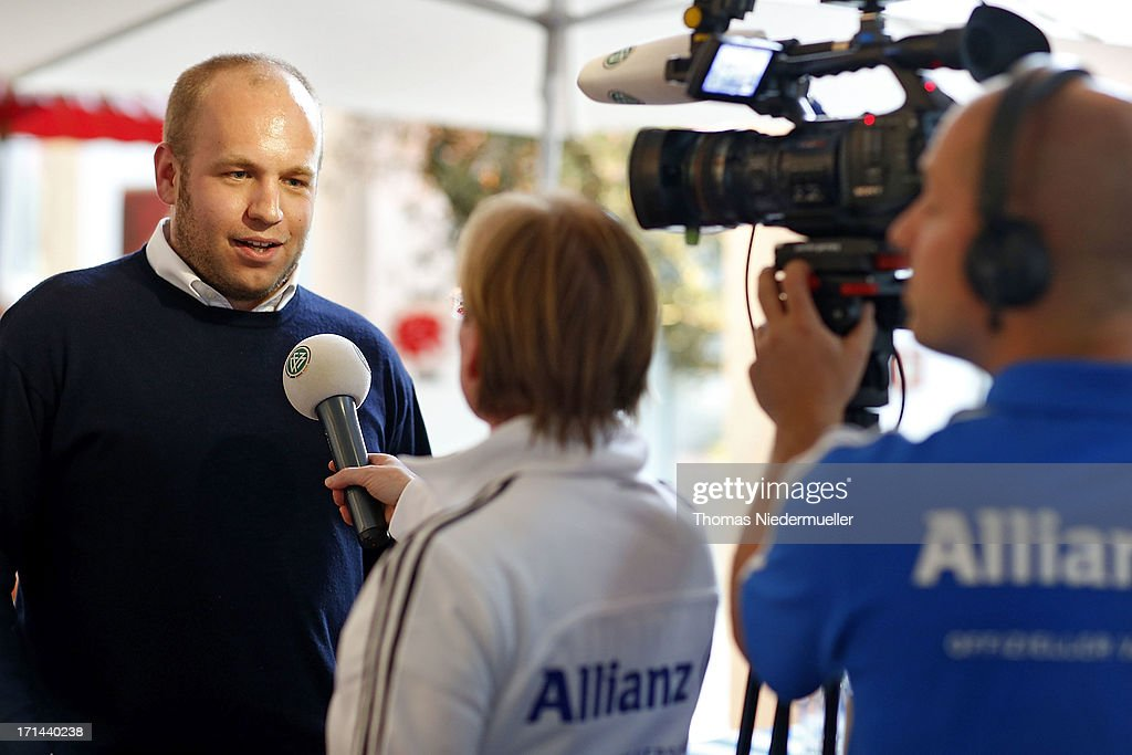 Julian Gnan of Allianz (L) gives an Interview during the DFB Team & Sponsors Cooking Event on June 24, 2013 in Munich, Germany.