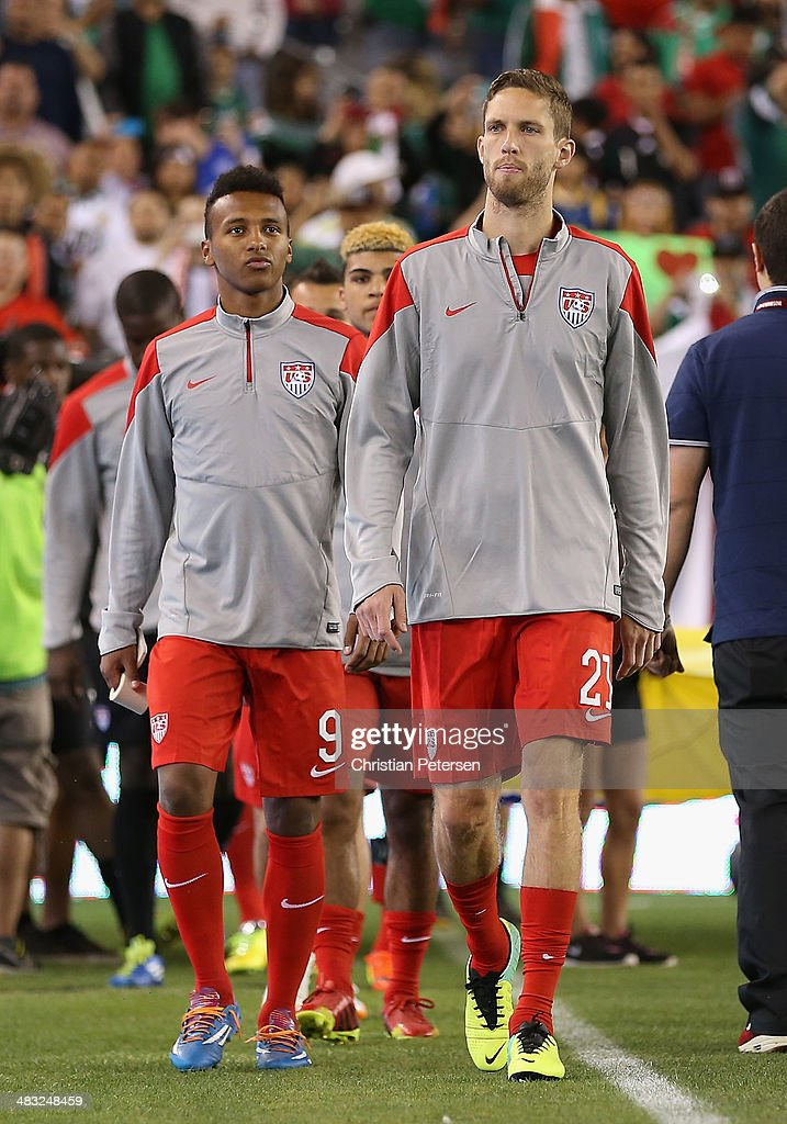 Julian Green and Clarence Goodson of USA lead teammates onto the field before the International Friendly against Mexico at University of Phoenix...