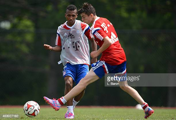 Julian Green is challenged by Lucas Scholl during a training session on day three of the Audi Summer Tour USA 2014 at Montclair University on August...