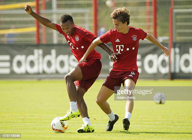Julian Green of Bayern Muenchen is challenged by Gianluca Gaudino during the FC Bayern Muenchen Training Session at the Bayern Munich training...