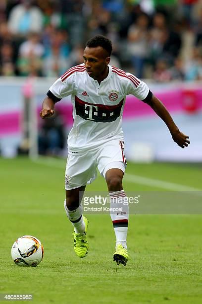 Julian Green of Bayern runs with the ball during the Telekom Cup 2015 Semi Final match between Borussia Moenchegladbach and Hamburger SV at...