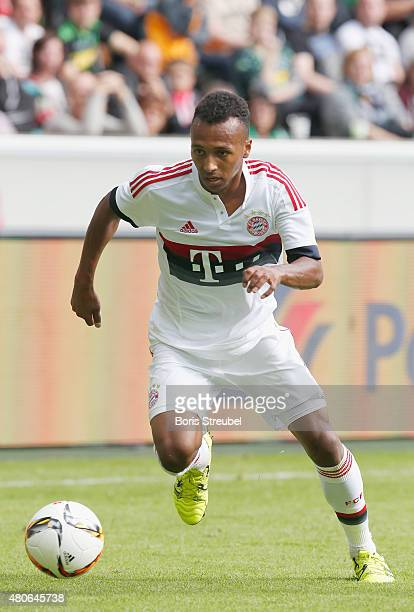 Julian Green of Bayern runs with the ball during the Telekom Cup 2015 third place match between Borussia Moenchengladbach and FC Bayern Muenchen at...