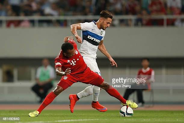 Julian Green of FC Internazionale challenges Danilo D'Ambrosio of FC Bayern Muenchen during the international friendly match between FC Bayern...